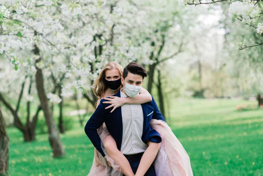 Bride and groom wearing masks during COVID-19
